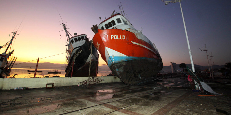 A boat stands on a dock after it was lifted by an earthquake-triggered tsunami in Coquimbo, Chile, Sept. 17, 2015. Several coastal towns were flooded from...