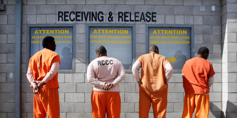 Image: Prisoners from Sacramento County await processing after arriving at the Deuel Vocational Institution in Tracy, Calif.