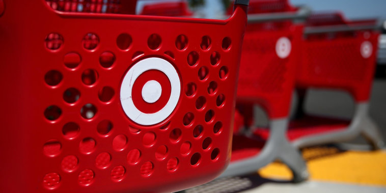 Image: Shopping carts sit in front of a Target store