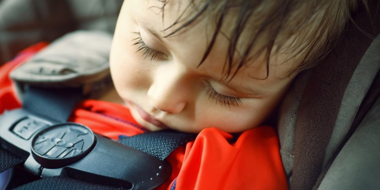 Toddler sleeping in a dangerously hot car