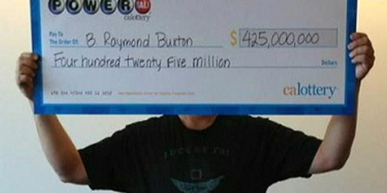 Powerball winner covers face with check