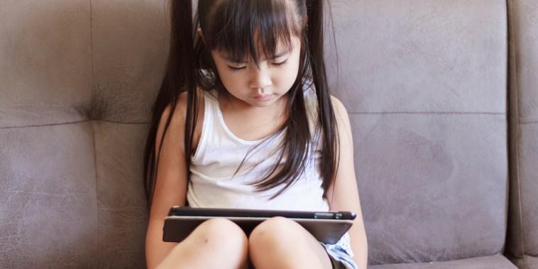 Little girl playing on ipad