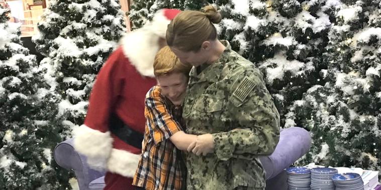 Military mom surprises son during visit to Santa.