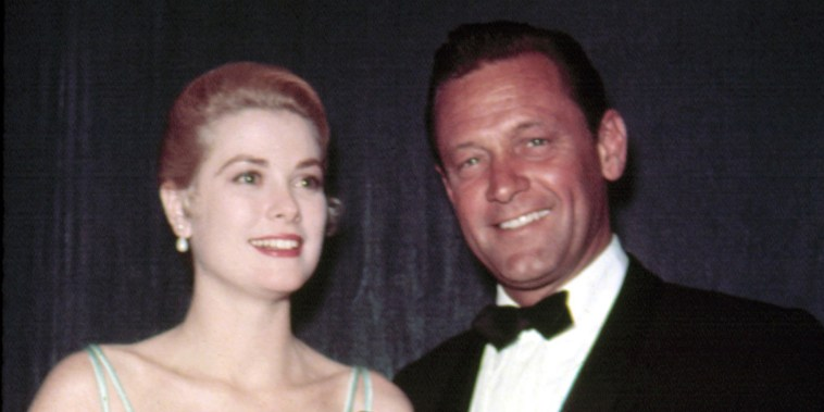 1954: Best Actress GRACE KELLY [The Country Girl] accepts Oscar from the previous year's Best Actor