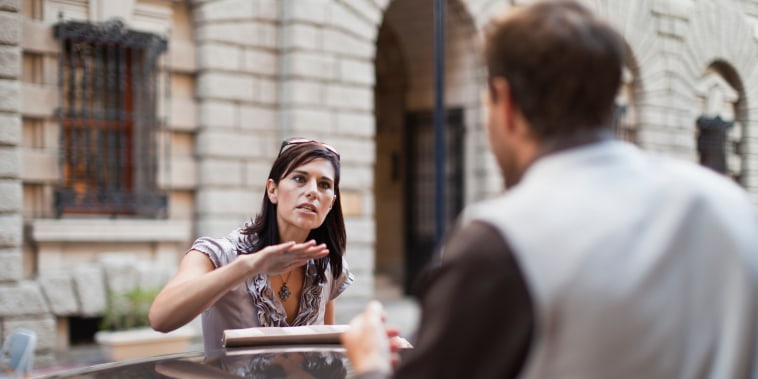 Image: A couple argues on the street