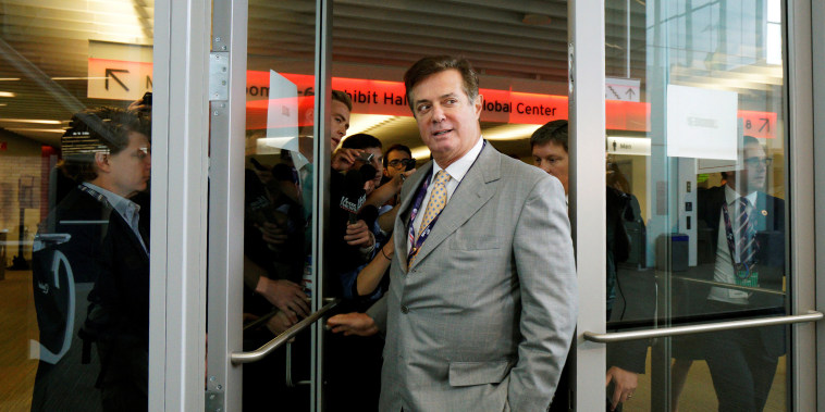 Image: Paul Manafort, campaign manager to Republican Presidential Candidate Trump, leaves as reporters ask about the Republican National Convention Committee on Rules in Cleveland