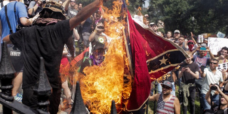 Image: Protesters burn a confederate flag on Aug. 19, 2017, in Boston, Massachusetts.