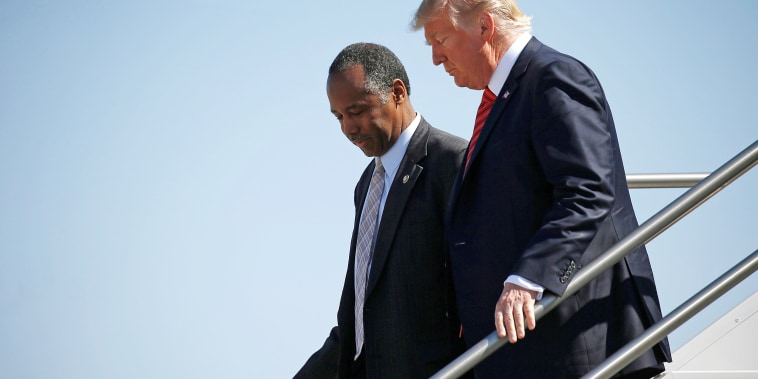 Image: U.S. President Donald Trump and U.S. Secretary of Housing and Urban Development Ben Carson descend from Air Force One in Reno, Nevada