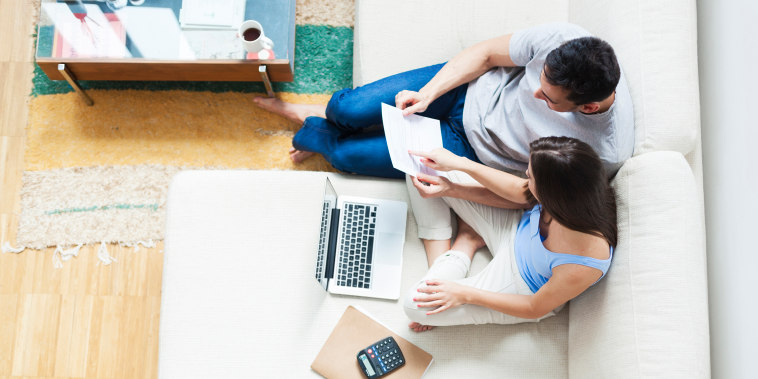 Image: Young couple working on their family finances.