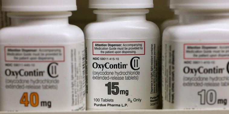 Image: Bottles of Purdue Pharma L.P. OxyContin medication sit on a pharmacy shelf in Provo, Utah, on Aug. 31, 2016.