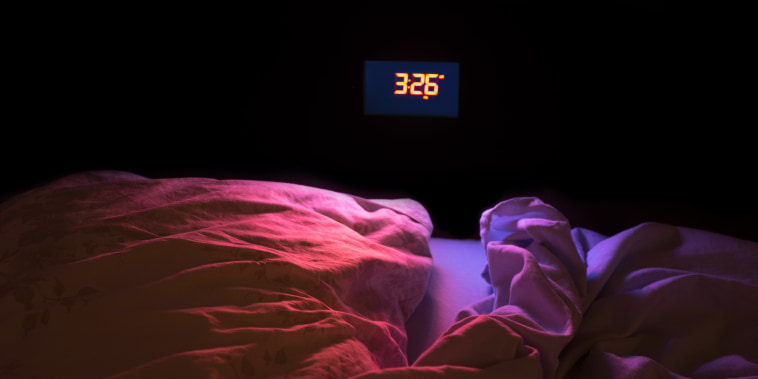 Image: The glow of an alarm clock in the middle of the night.
