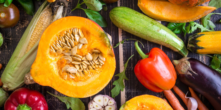 Close up of fresh vegetables on a rustic dark table. Autumn background. Healthy eating. Sliced pumpkin, zucchini, squash, bell peppers, carrots, onions, cut garlic, tomatoes, eggplant. Top view; Shutterstock ID 329491412; PO: today.com mish
