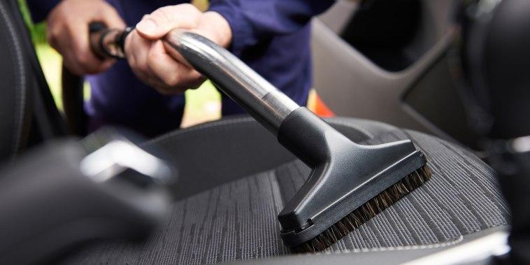Cleaning interior of car, vacuum car