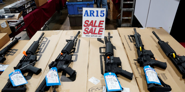 Image: AR-15 rifles are displayed for sale at a gun show