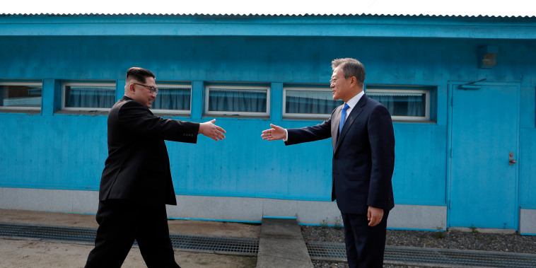 Image: Kim Jong Un and Moon Jae-in shake hands over the military demarcation line.
