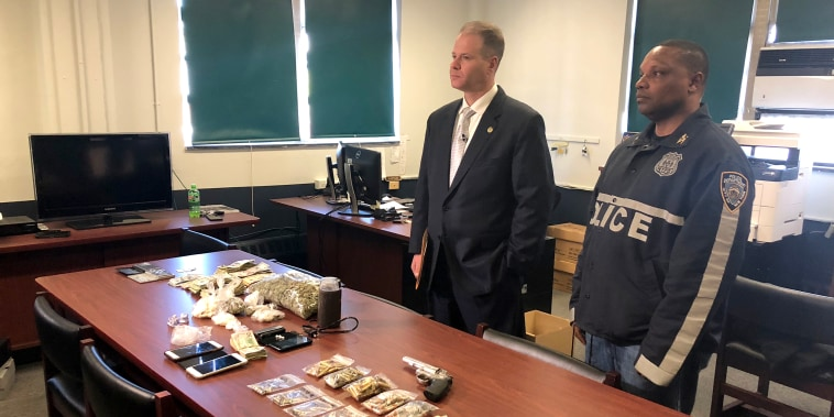 Police display drugs seized during early morning raids in Brooklyn, New York.