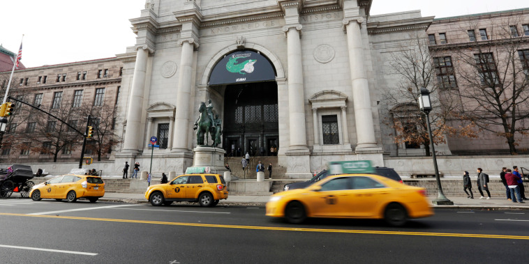 Image: Taxis pass in front of The American Museum of Natural History