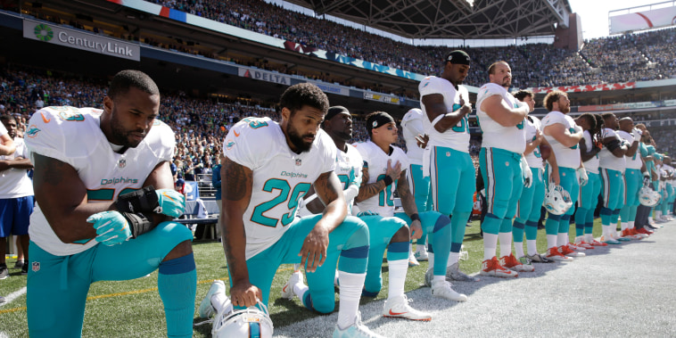 Image: NFL players kneeling