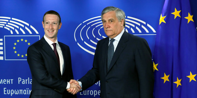 Image: Facebook's CEO Mark Zuckerberg shakes hands with European Parliament President Antonio Tajani at the European Parliament in Brussels