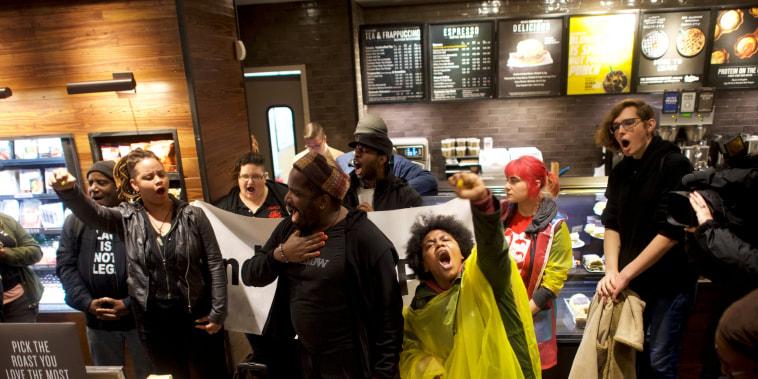 Image: Protesters demonstrate inside a Center City Starbucks in Philadelphia