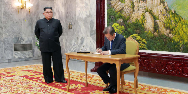 Image: South Korea's President Moon Jae-in signs a guestbook