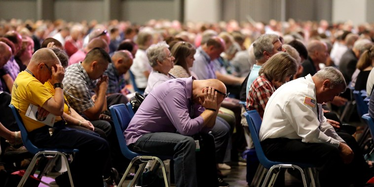Image: People pray during the annual meeting of the Southern Baptist Convention on June 14, 2016, in St. Louis.