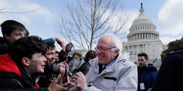 Senator Sanders greets students gathering outside the U.S. Capitol as part of a nationwide walk-out of classes to demand stricter gun laws