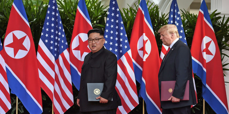 Image: U.S. President Donald Trump and North Korea's leader Kim Jong Un react during their summit at the Capella Hotel on Sentosa island in Singapore