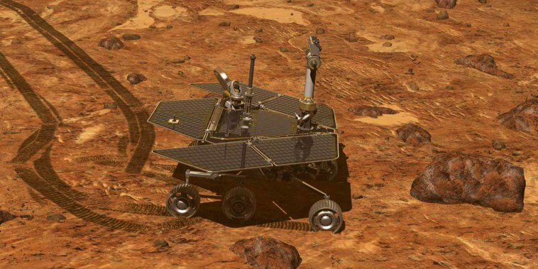 Image: Controlling the rover from Earth, scientists drive the rover along Mars' surface inspecting geological features.