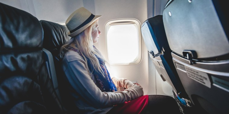 Woman sitting on airplane