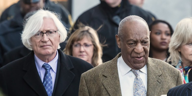 Bill Cosby and his attorney Tom Mesereau leave the Montgomery County Courthouse