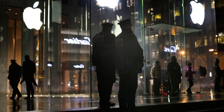 Image: Police stand outside an Apple Store in New York