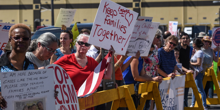 Image: Protesters hold signs in front of a Homeland Security facility in Elizabeth, New Jersey