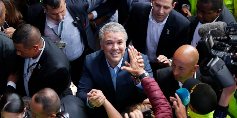 Image: Ivan Duque, candidate of the Democratic Center party, greets supporters after voting during the presidential runoff election in Bogota