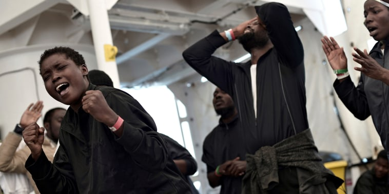 Image: Migrants rejoice before disembarking the rescue ship Aquarius in Valencia