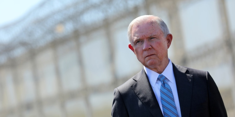 Image: Jeff Sessions looks out towards Mexico as he stands by a secondary border fencer during visit to the U.S. Mexico border fence