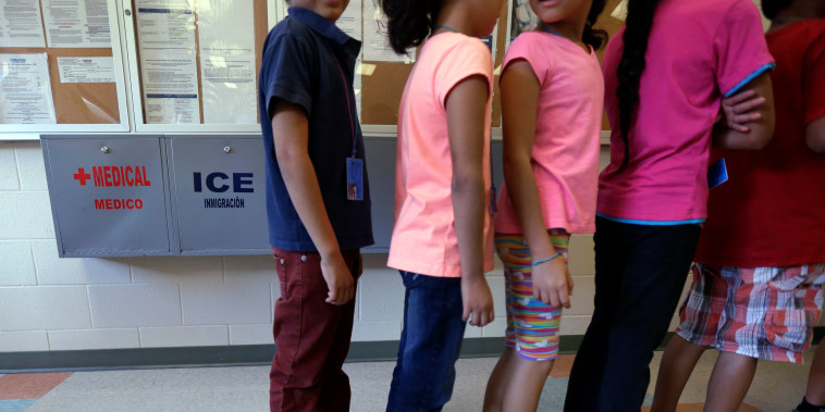 Detained immigrant children line up in at a temporary home for immigrant women and children detained at the border in 2014 in Karnes City, Texas.