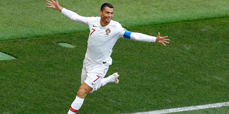 Image: Portugal's Cristiano Ronaldo celebrates after scoring the opening goal against Morocco