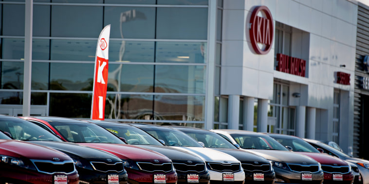 Image: Kia Motors Corp. vehicles sit outside a Kia car dealership in Ottawa