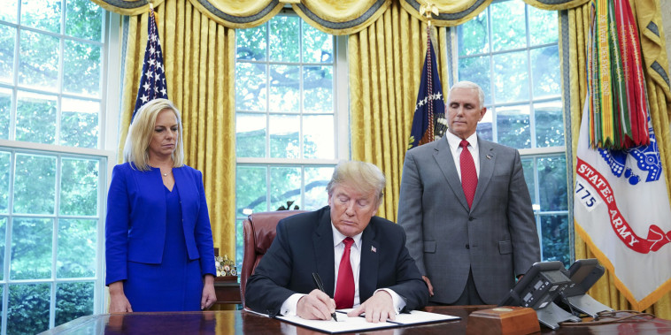 Image: Trump signs an executive order on immigration