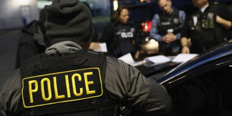 Image: U.S. Immigration and Customs Enforcement (ICE) officers prepare for morning raids to arrest undocumented immigrants