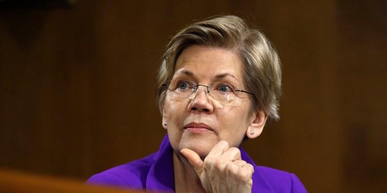 Image: Sen. Elizabeth Warren, D-Mass., listens during a hearing on Capitol Hill in Washington