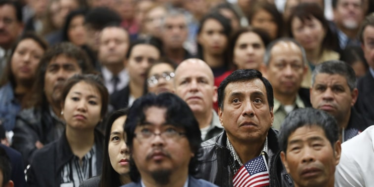 New U.S. citizens attend a naturalization ceremony in Los Angeles