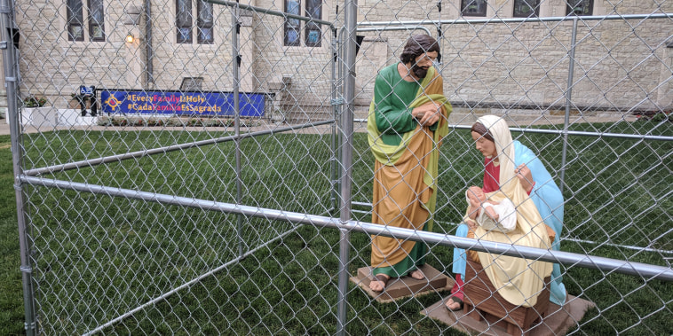 Statues of Jesus and Mary are placed behind a cage at the Christ Church Cathedral