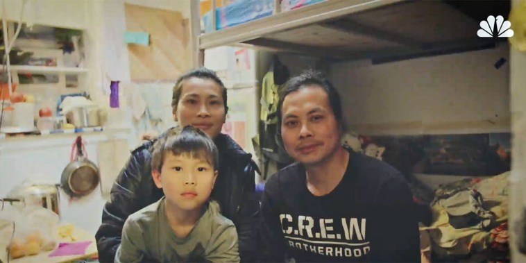 Jinyan Yu and her family in their SRO in San Francisco.