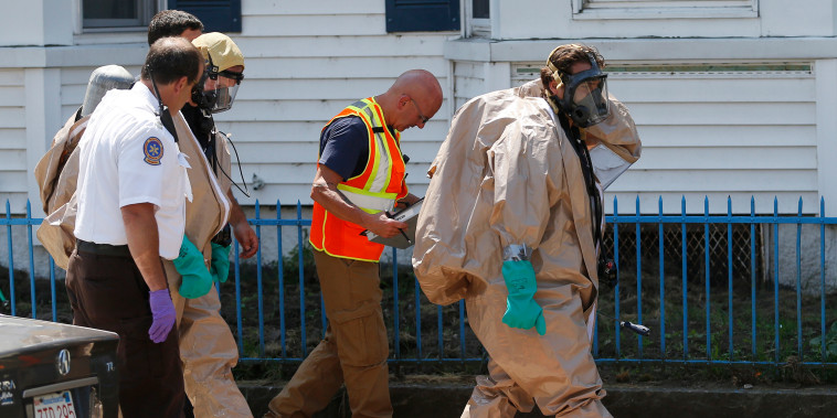 Image: embers of the Hazmat unit respond to the scene of an overdose that killed two people