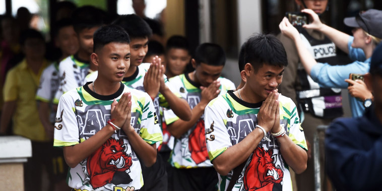 Image: Some of the boys rescued from a flooded cave arrive for a news conference in Chiang Rai