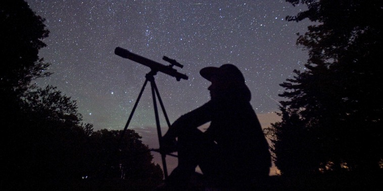 A stargazer waits for the Perseid meteor shower to begin near Bobcaygeon