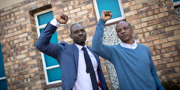 The first graduate Devon Simmons of the Prison to Pipeline Program in America (to the left), and a South African recent graduate and ex-offender Morgan Zonke (to the  right) pose for a portrait during the launch of the first P2P program in South Africa, o