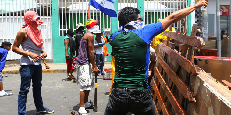 Demonstrators clash with riot police during a protest against Nicaragua's President Daniel Ortega's government in Masaya